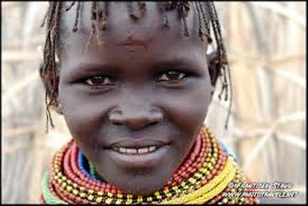 They dress following Samburu custom- beads and goat or fish skins,